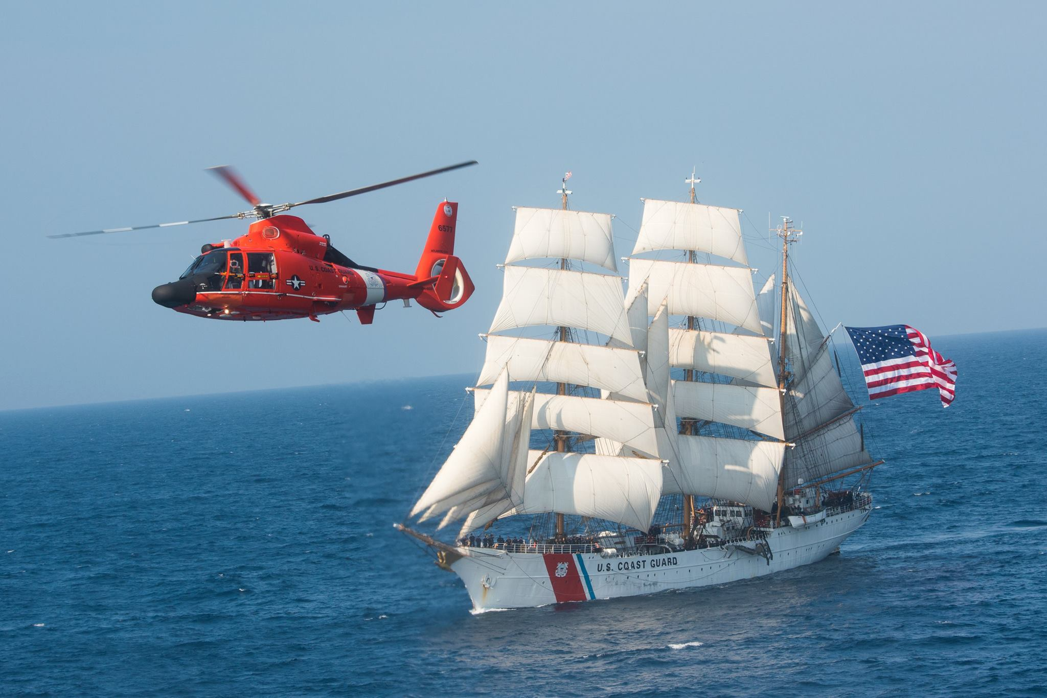 HH-65 Dolphin and USCGC Eagle