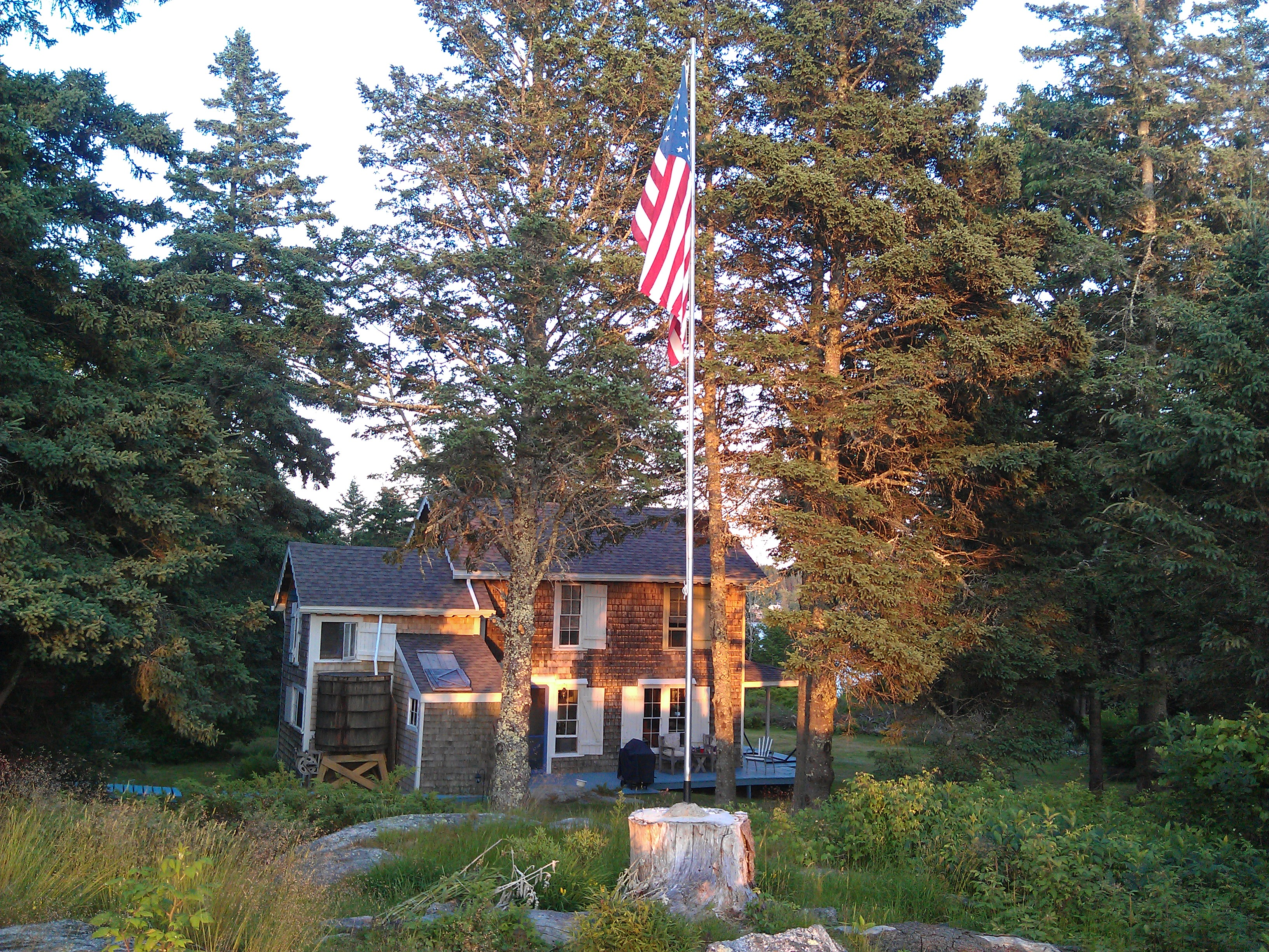 Flag pole at sunset