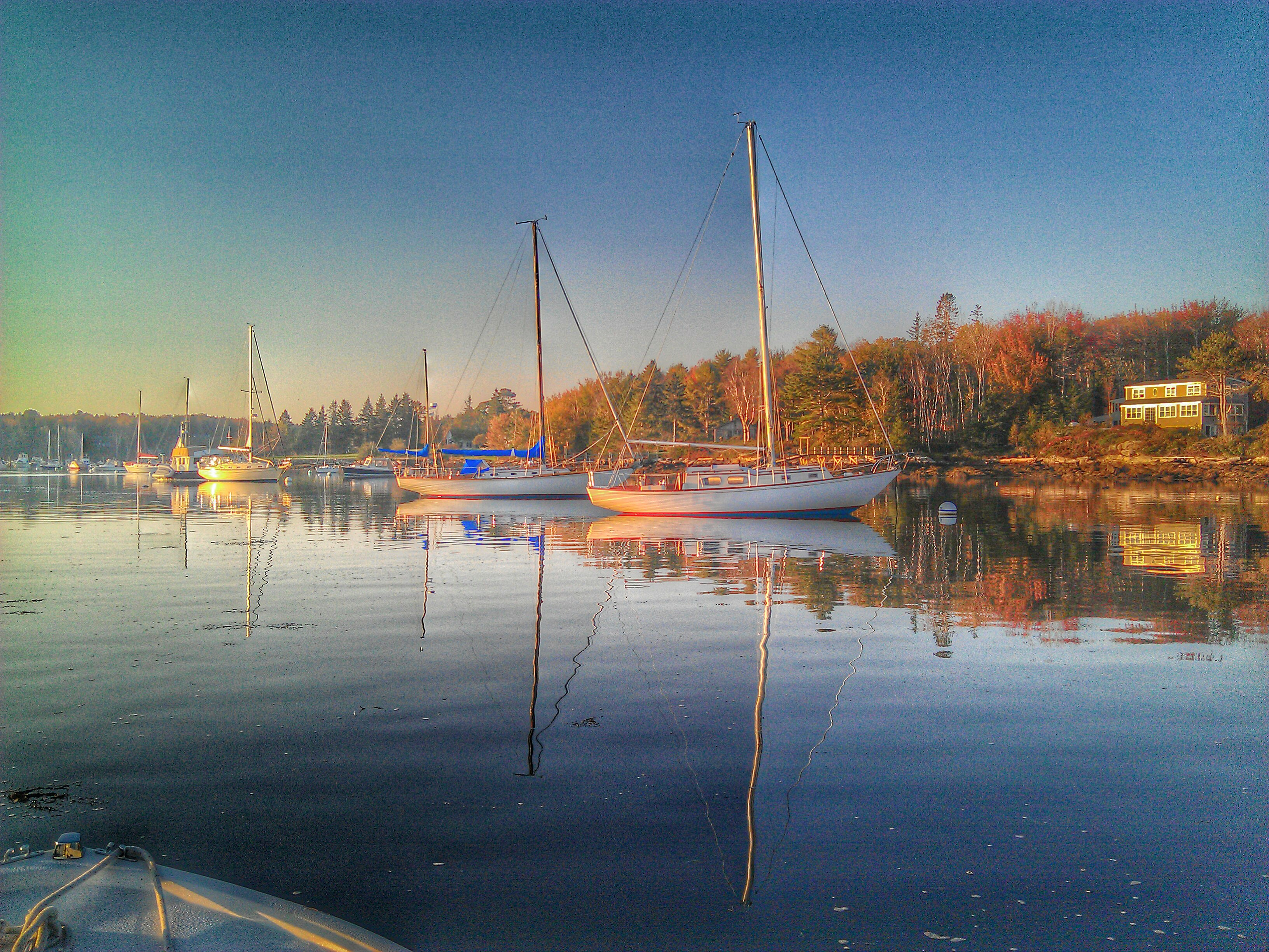 Boats on moorings in Maine at sunrise.