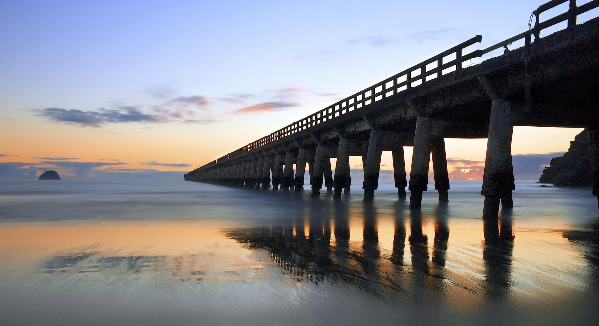 Sunset behind a pier